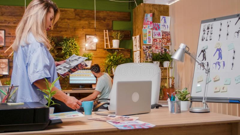 The office of the creative agency in which two colleagues work. Team work and busy people royalty free stock photo