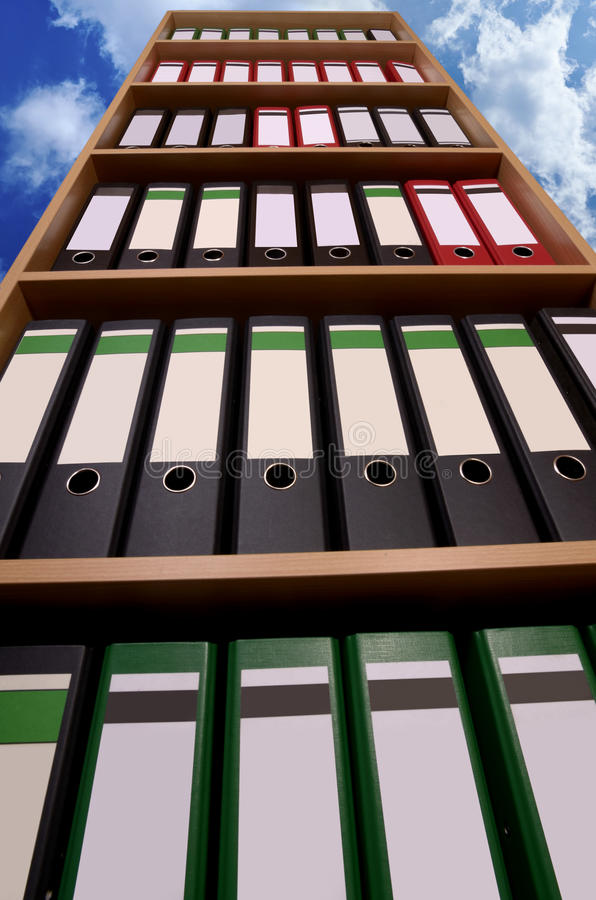 Office cupboard with folders before cloudy sky stock image