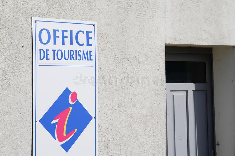 Office de tourisme logo sign wall building means information center in french for tourist tour help. The office de tourisme logo sign wall building means royalty free stock photo