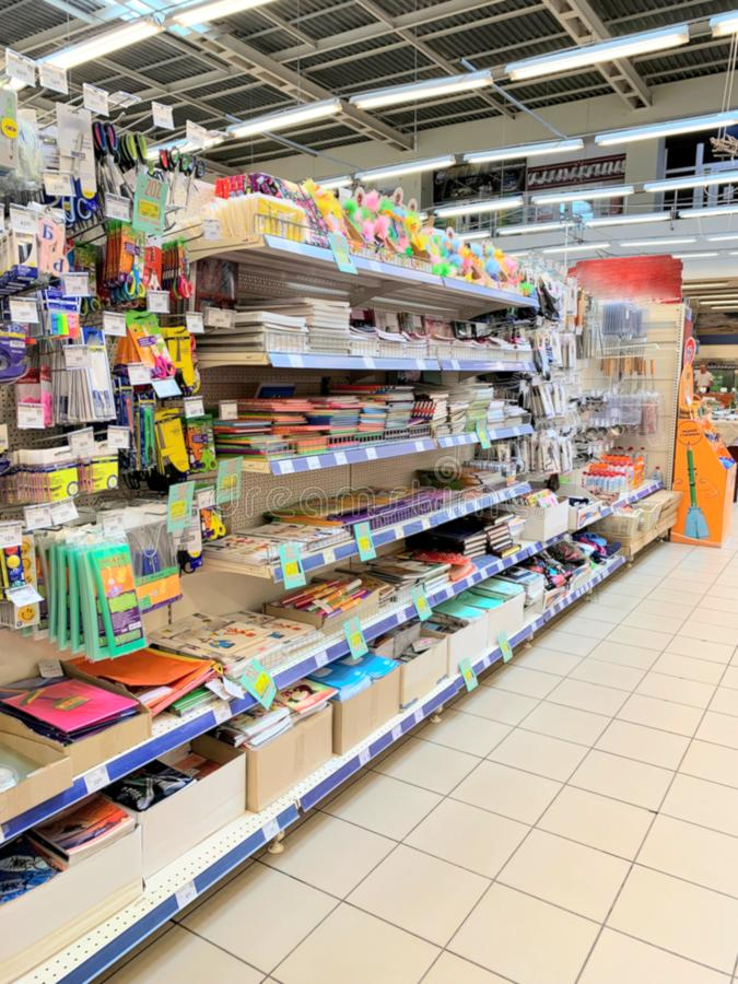 Office department in a supermarket. Shelves with goods for a schoolboy. Pens, pencils, assortment stock images