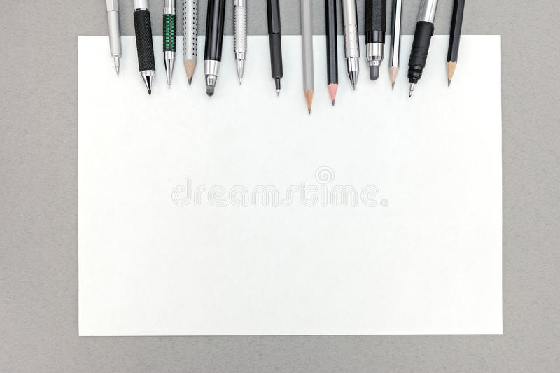 office drawing tools. download office desk with blank sheet of paper and various drawing tools stock photo image