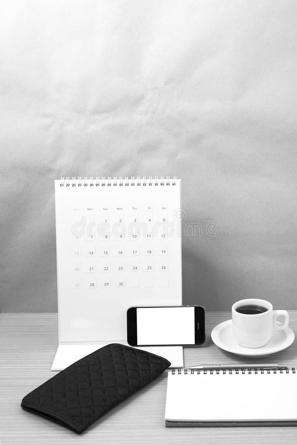 Download office desk coffee with phonecalendarnotepad black and white stock image