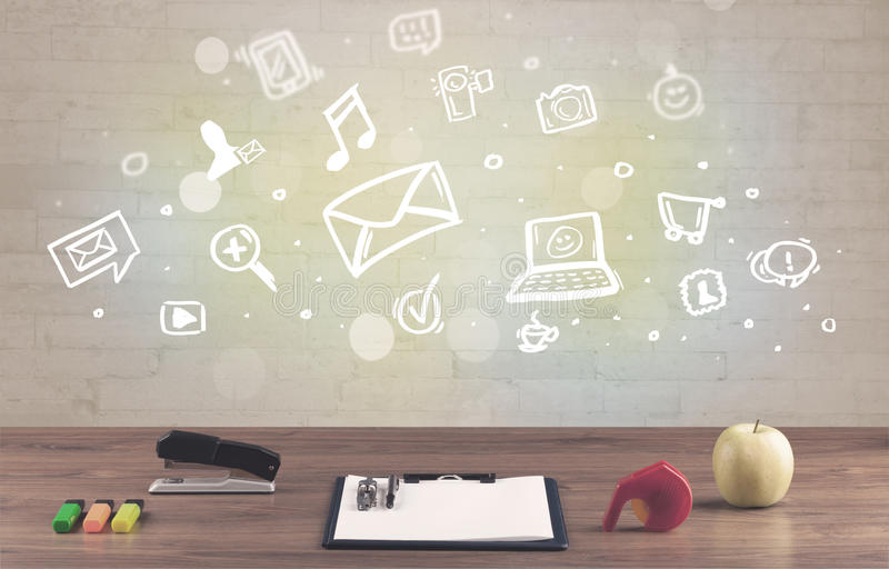 Office desk with communication icons. Social media online communication concept with icons and close up of business office desk full of work equipement royalty free stock photography