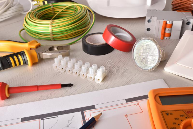 Office desk of electrical engineer with project and tools elevated royalty free stock photo