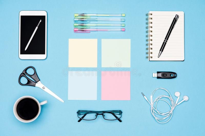 Office desk flat lay. Top view of working space table with morning coffee, smartphone and stationery, office supplies. Office desk flat lay. Top view of working stock photos
