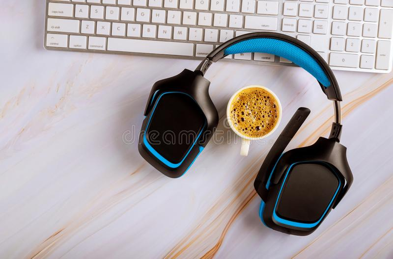 Office desk with headset call center manager desktop on cup of coffee top view white background royalty free stock photography