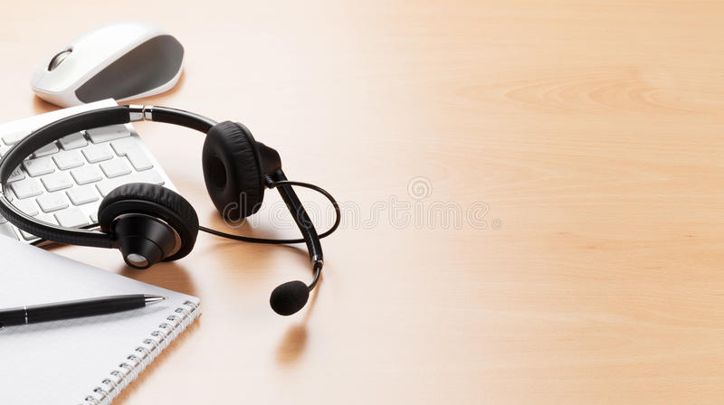 Office desk with headset. Call center support royalty free stock photos
