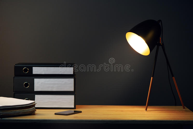 Office desk with lamp and ring binders stock photo