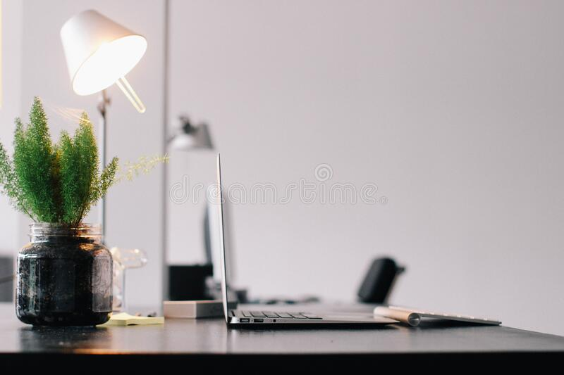 Office desk with laptop royalty free stock images