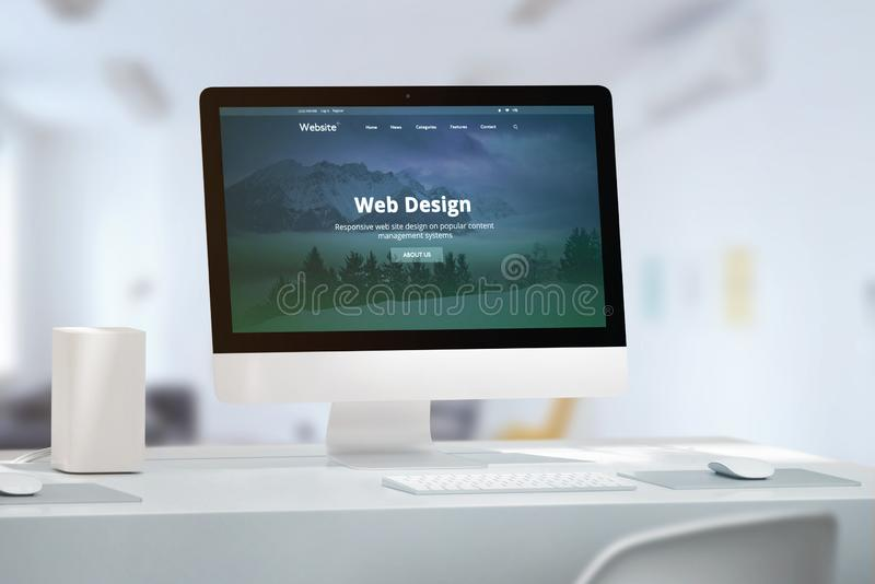 Office desk with modern computer monitor and responsive web site off web design studio. Presentation royalty free stock photo