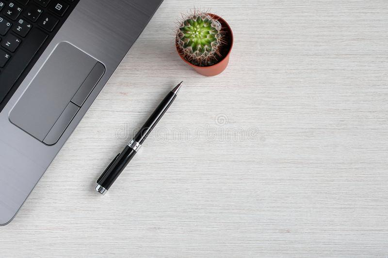 Office items on the table. An office desk with office items in a work place scene royalty free stock image