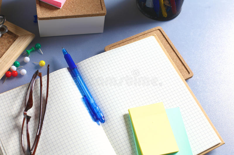 Office desk with papers and headphones.  stock photo