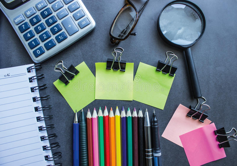 Office Desk. With pen and colored sticky notes paper stock photos