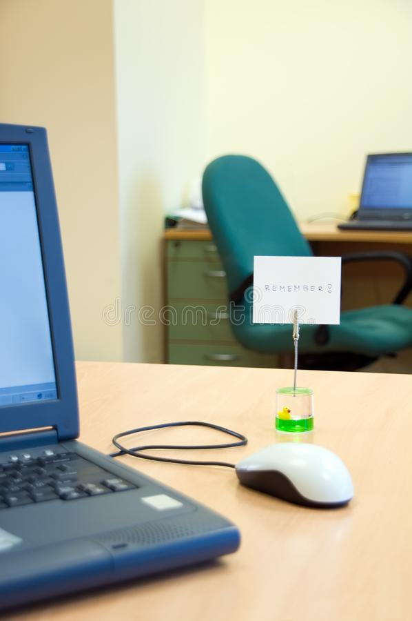 Office desk with reminder note stock images
