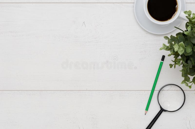 Office desk table with coffee cup and supplies stock images
