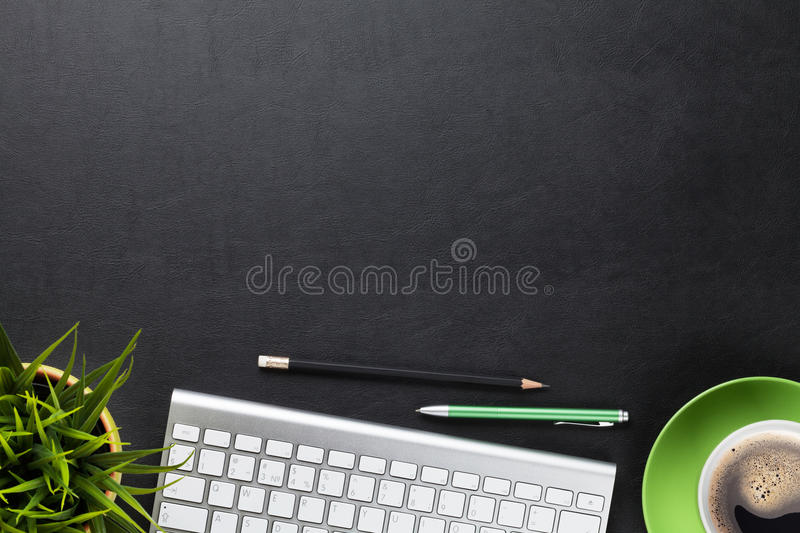 Office desk table with computer, flower and coffee cup royalty free stock images