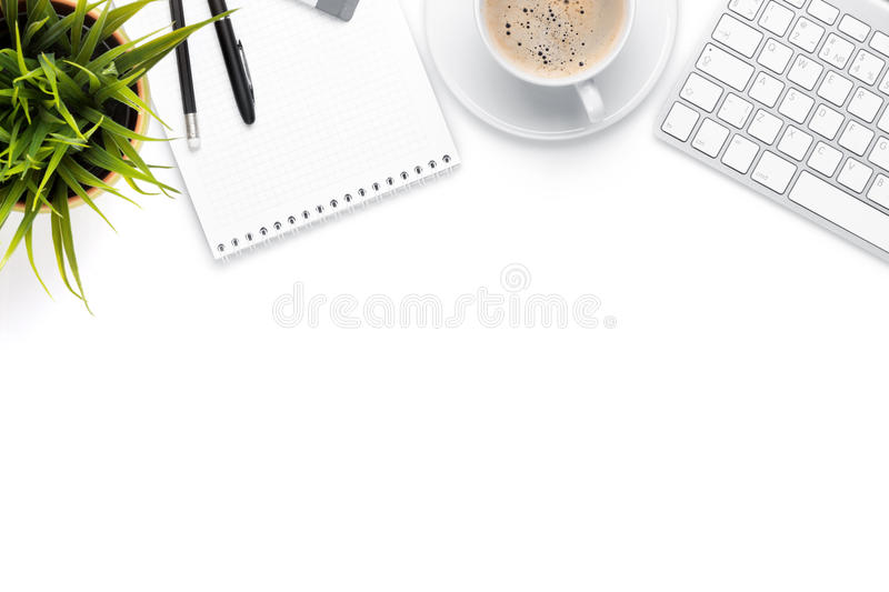 Office desk table with computer, supplies, coffee cup and flower. Isolated on white background. Top view with copy space royalty free stock images