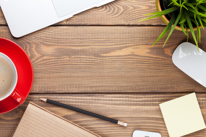 Office desk table with computer, supplies, coffee cup and flower stock image