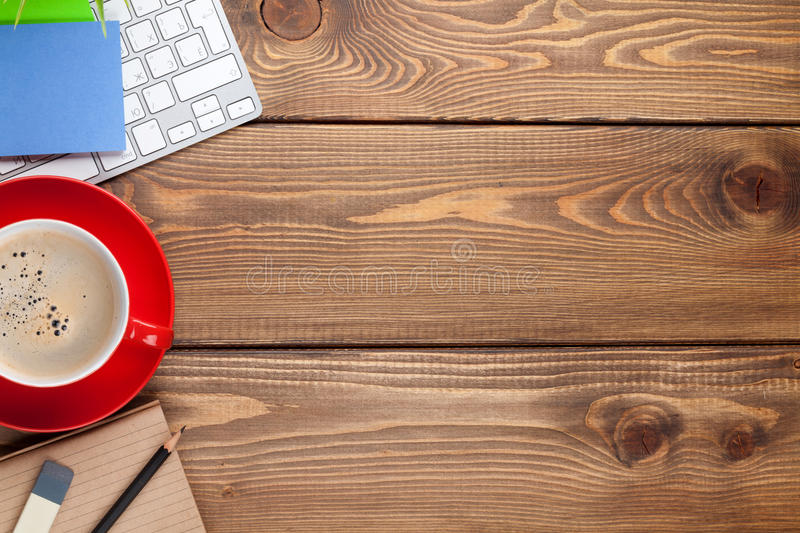 Office desk table with computer, supplies and coffee cup. Top view with copy space royalty free stock photography