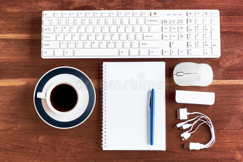 Office desk table with computer, supplies and coffee cup. stock image