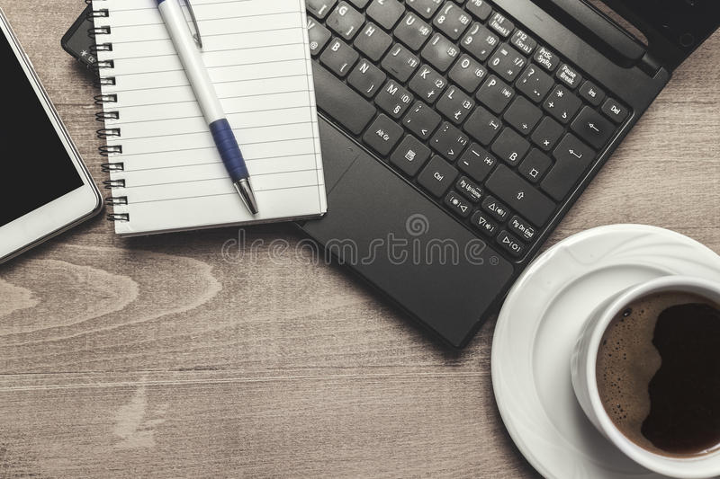 Office desk table with computer, supplies and coffee cup. royalty free stock photos