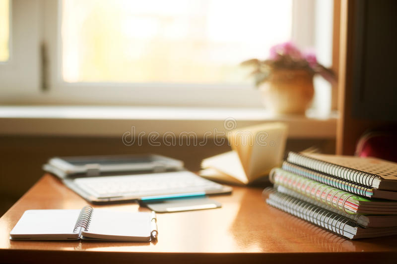 Office desk table with computer, supplies, flower. Copy space for text royalty free stock images