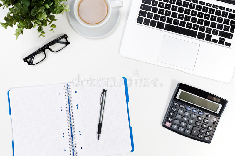 Office desk table with laptop, coffee cup and supplies top view royalty free stock photos