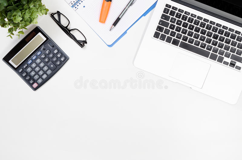 Office desk table with laptop, office supplies top view. Office white desk table with laptop, office supplies top view stock photo