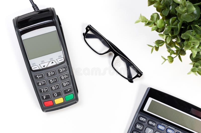 Office desk table with payment terminal and calculator stock photo