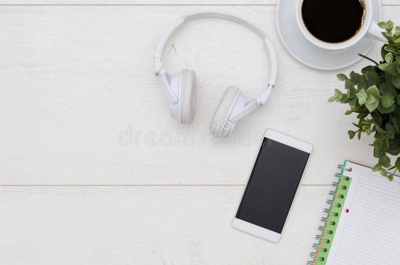 Office desk table with phone, headphones, and supplies royalty free stock photos