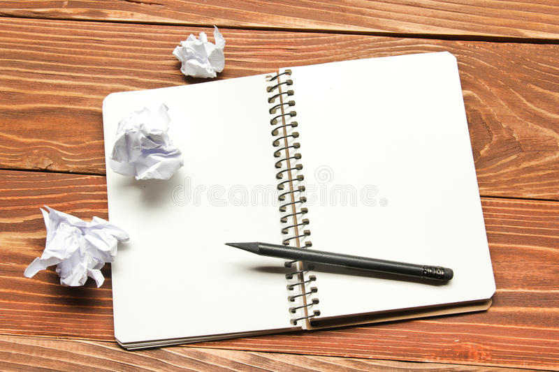 Office desk table with supplies and crumled paper. Top view. Copy space for text stock photos