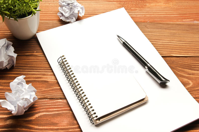 Office desk table with supplies and crumpled paper. Top view. Copy space for text stock images