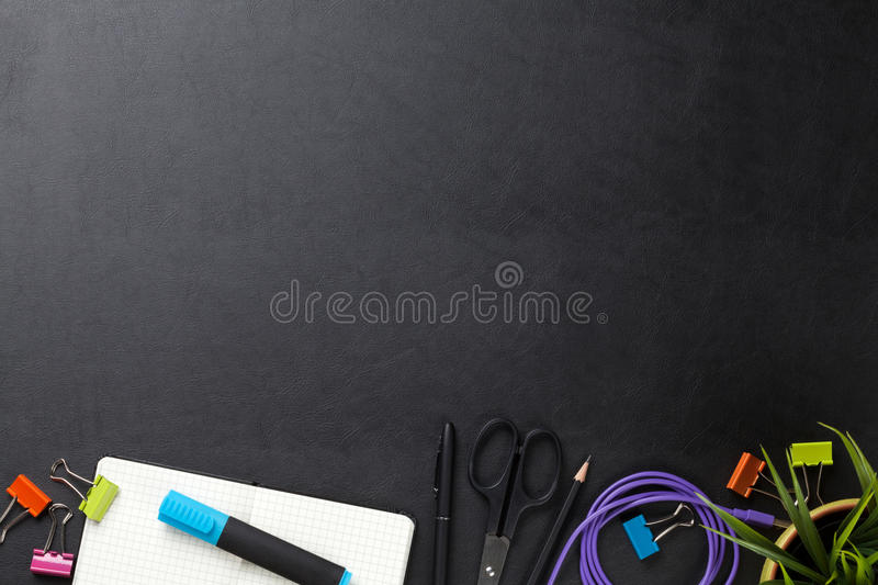 Office desk table with supplies. Office leather desk table with supplies. Top view with copy space royalty free stock images
