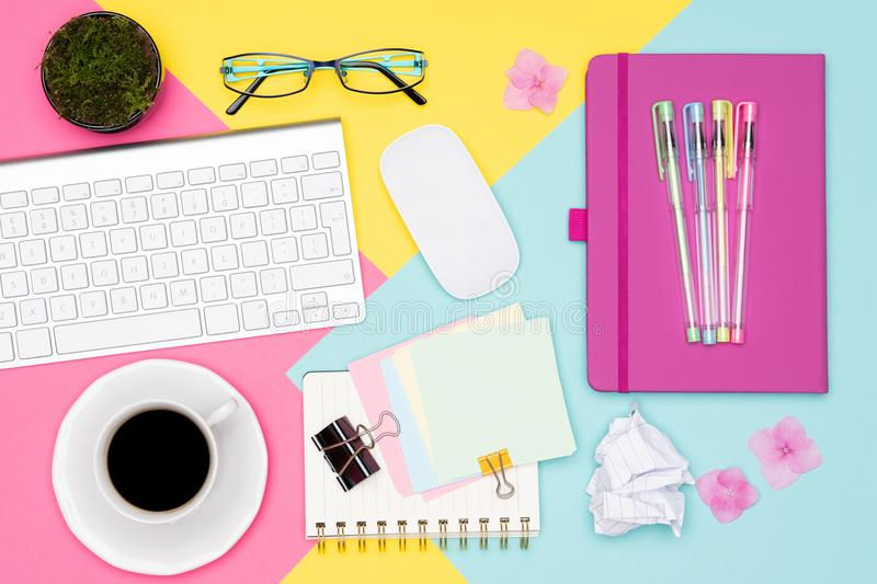 Office Desk Working Space Flat Lay. Top view photo of workspace with keyboard, notepad and coffee cup on pastel background. Office Desk Working Space Flat Lay royalty free stock image