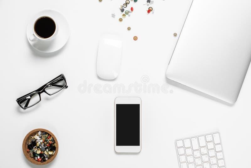 Office desktop with cellular phone closeup stock photos