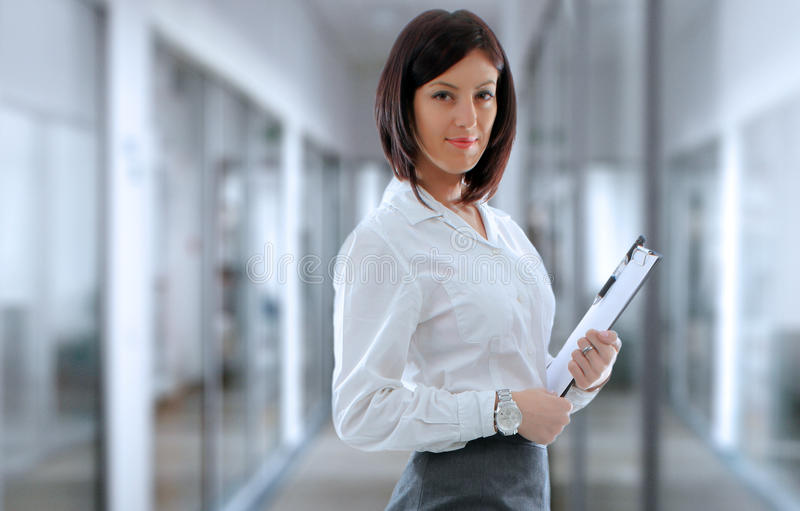 Office employee. Confident business woman employee in company office