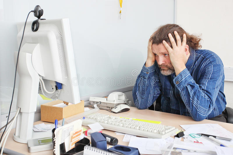 Office employee on his working place stock photo