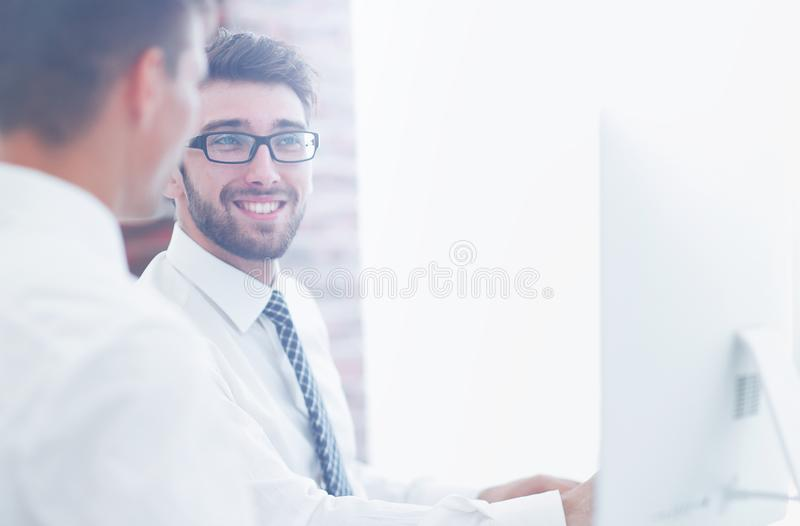 Office employees work on the computer royalty free stock photography