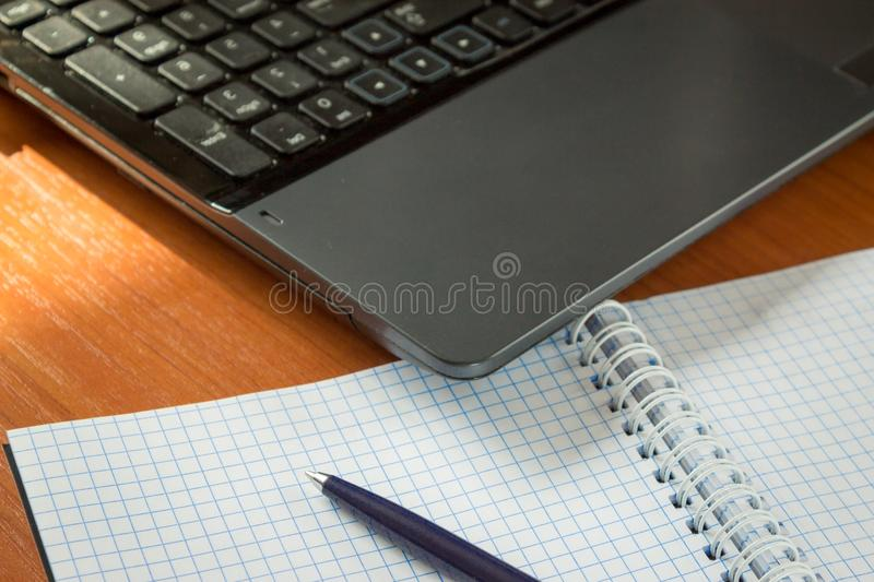 Office equipment notebook pen harmony table technology order royalty free stock images