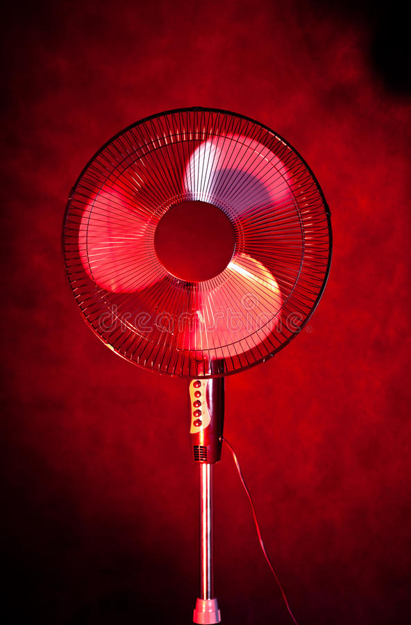 Office Fan On Dark Red Background Royalty Free Stock Photos