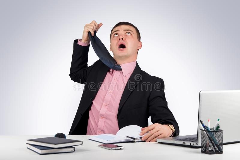 Funny businessman, hung a tie on gray background stock photos