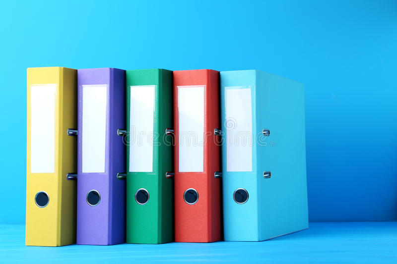 Office folders. Colorful office folders on blue background royalty free stock images