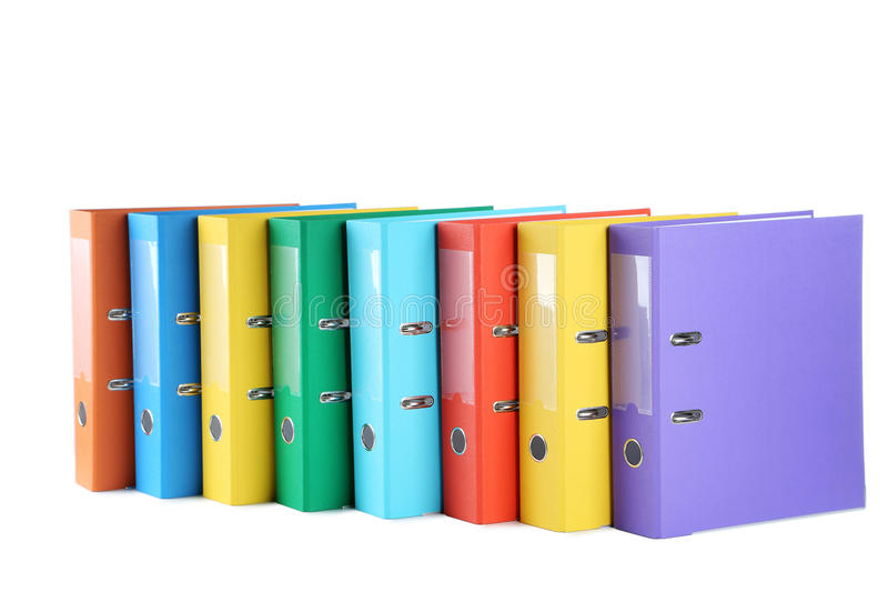 Office folders. Colorful office folders isolated on a white royalty free stock image