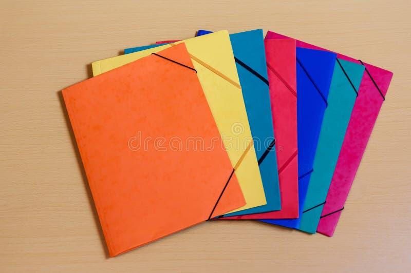 Office folders on desk. Multicolored office folders on desk stock photography