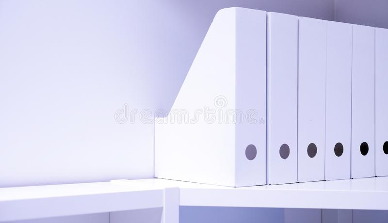 Office folders for documents. A folder with files on the sideboard in a bright modern office, archive and documents.  royalty free stock image