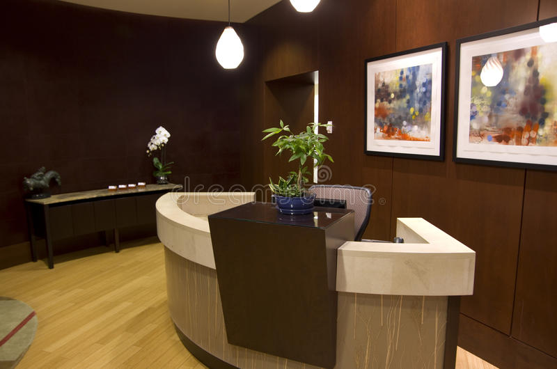 Office front desk reception. Nice interiors of the reception room of an office stock image