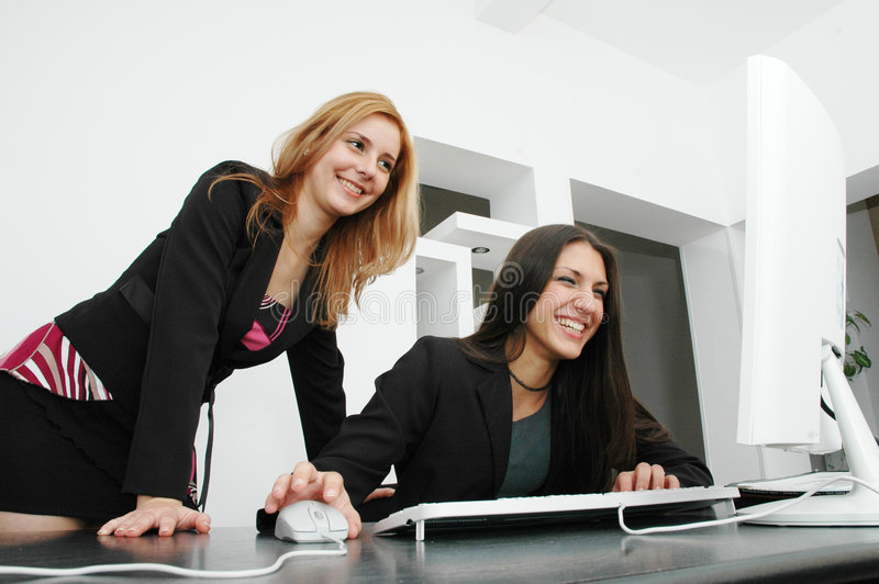 Office girls. Beautiful young girls laughing in the office