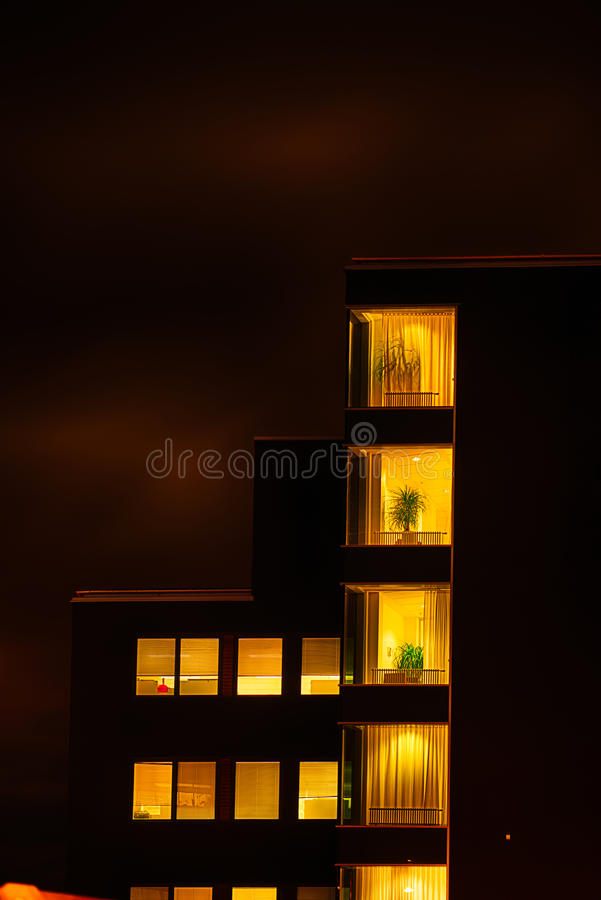 Office building at night stock image