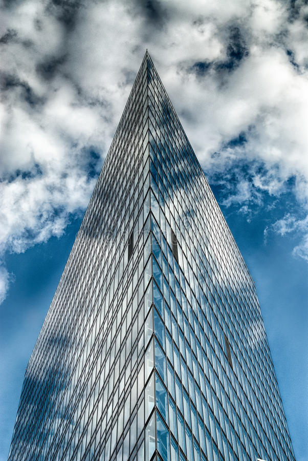 Office glass building in abstract. Office skyscraper towards a blue sky. Glass building in abstract royalty free stock photography