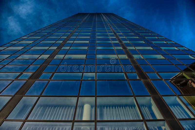 Office glass building in abstract. Office skyscraper towards a blue sky. Glass building in abstract royalty free stock photo